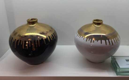 gold and black vases