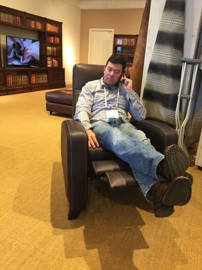 Here's my handsome guy, taking a work call in this powered leather recliner from NS Designs.